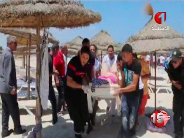 In this screen grab taken from video provided by Tunisia TV1, injured people are treated on a Tunisian beach.