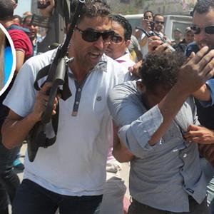 Police officers surround a man suspected of being involved in the deadly attack on a resort in Sousse, Tunisia, in which Irishwoman Lorna Carty (inset) was killed
