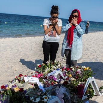 Mourners on the beach at Sousse in Tunisia after last week's attack