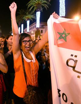 Moroccans shout slogans and hold placards during a demonstration in Rabat.
