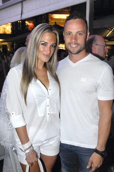 Oscar Pistorius and Reeva Steenkamp at an event two weeks before he shot and killed her