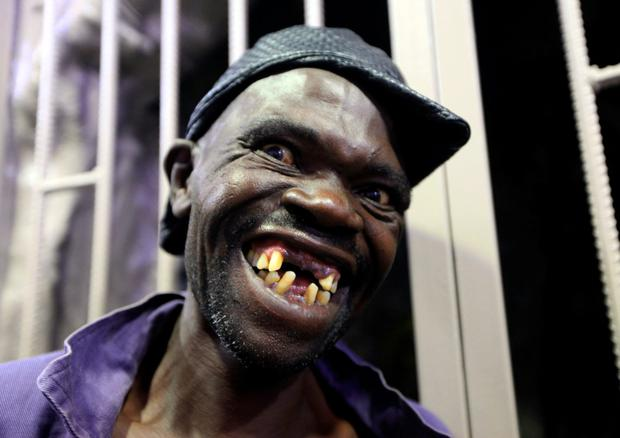 Mison Sere smiles after winning the 2015 edition of the Mr Ugly competition in Harare