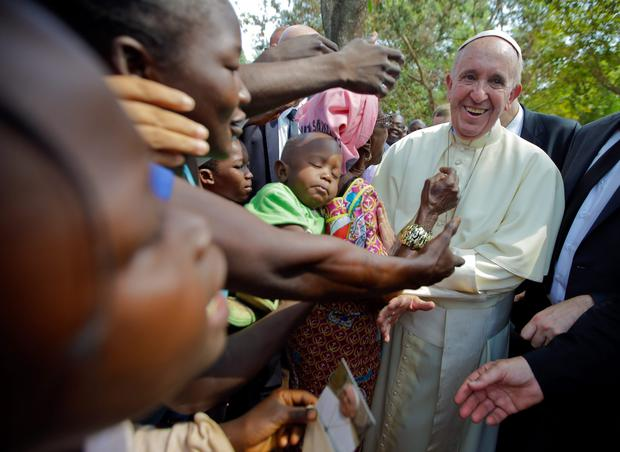 Pope Francis is cheered by locals as he visits a refugee camp, in Bangui, Central African Republic
