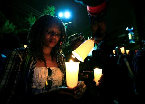 People light candles during a street concert in Nairobi. Photo: Reuters/Noor Khamis