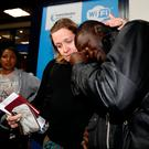 Holiday maker Sara Wilkins of Britain consoles fellow passenger Ebrima Jagne of Gambia after they were evacuated by travel operator Thomas Cook from Gambia to Manchester Airport in Manchester northern England, January 18, 2017. Photo: REUTERS/Phil Noble