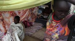 A girl with measles sits under a tent in a refugee camp in South Sudan's capital Juba in 2014 Photo: Reuters