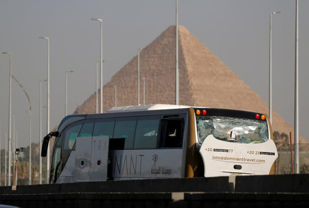 Attack: The damaged bus was close to the pyramids at Giza. Photo: Reuters
