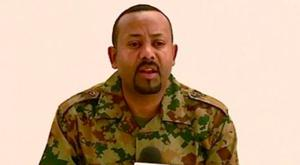 Defiant: Ethiopia's Prime Minister Abiy Ahmed addresses the public on TV dressed in military fatigues. Photo: Getty Images