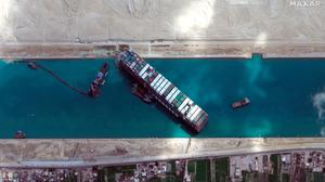 This satellite image shows the cargo ship MV Ever Given surrounded by recovery operations in the Suez Canal. Photo: Maxar Technologies/AP