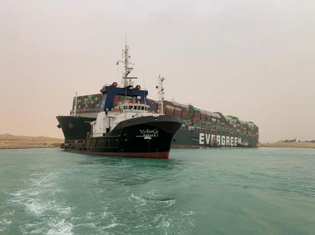 A container ship which was hit by strong wind and ran aground is pictured in Suez Canal, Egypt March 24, 2021.