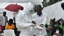 A volunteer health worker practises using a personal protective equipment (PPE) suit at a newly-constructed Ebola virus treatment centre in Monrovia.