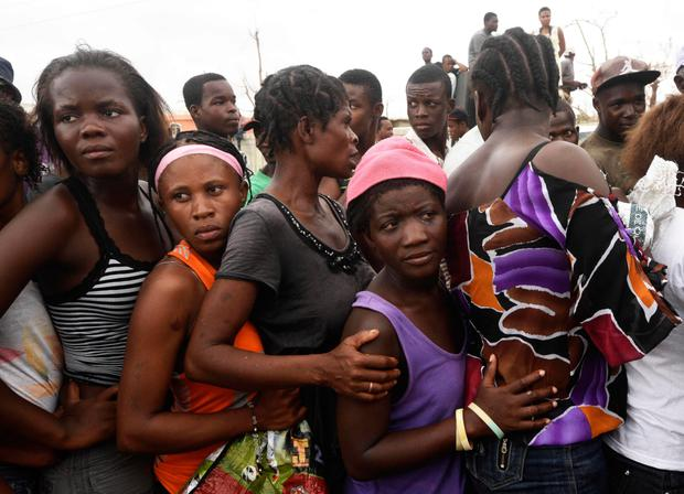 People queue for food and clothes being distributed at a shelter in Port-Salut, southwest of Port-au-Prince, on October 9, 2016, days after the passage of Hurricane Matthew through Haiti. Picture: Getty Images