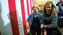 Getaway: Democratic candidate Senator Elizabeth Warren is led out by aide Nora Keefe following a rally in Davenport, Iowa. Photo: Brian Snyder/Reuters