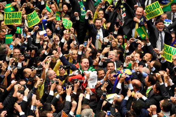Brazil's lawmakers celebrate after they reached the votes needed to authorise President Dilma Rousseff's impeachment to go ahead, at the Congress in Brasilia. Photo: AFP