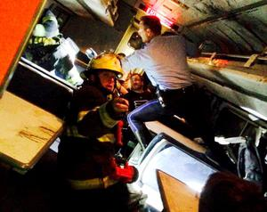 A rescuer searches for injured people inside the derailed Amtrak train in Philadelphia
