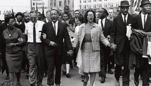 The Rev Martin Luther King and his wife Coretta among the marchers in Selma, Alabama in 1965. The march has since passed into history
