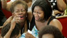 Parishioners mourn at the service in Charleston