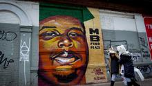 Children walk past a mural of Michael Brown in the Bushwick neighborhood of Brooklyn in New York. Brown was shot to death by police officer Darren Wilson on August 9th in Ferguson, Missouri