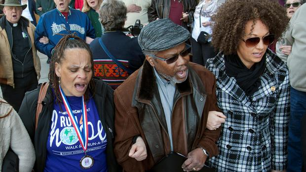 A QUESTION OF COLOUR: Rachel Dolezal attending a race-hate protest with supporters