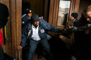 A City Marshal tries to stop a group of protesters from entering St. Louis City Hall in Missouri. REUTERS/Lucas Jackson