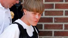 Police lead suspected shooter Dylann Roof, 21, into the courthouse in Shelby, North Carolina, June 18, 2015.   Roof, a 21-year-old with a criminal record, is accused of killing nine people at a Bible-study meeting in a historic African-American church in C