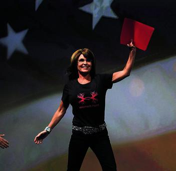 Former Alaska Governor Sarah Palin waves as she enters the stage to speak during the NRA-ILA Leadership Forum at the George R. Brown Convention Center, the site for the National Rifle Association's annual meeting in Houston, Texas on May 3, 2013. President Barack Obama and national media are demonizing law-abiding gun owners in the wake of recent violent acts, National Rifle Association leaders and political allies said on Friday at its first convention since the Connecticut school massacre. Organizers expect some 70,000 attendees at the 142nd NRA Annual Meetings & Exhibits in Houston, which began on Friday and continues through Sunday. REUTERS/Adrees Latif (UNITED STATES - Tags: SOCIETY POLITICS TPX IMAGES OF THE DAY)