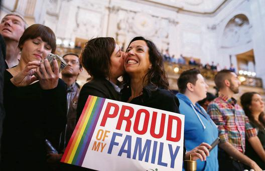 A couple celebrates the US Supreme Court ruling on same-sex marriage at City Hall, San Francisco