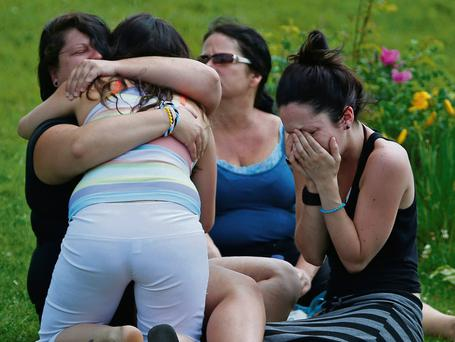Locals comfort each other after the tragedy in Lac-Megantic
