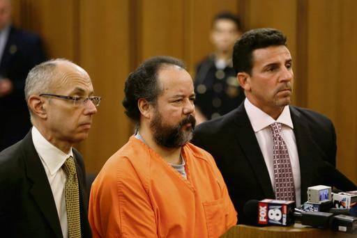 Ariel Castro with his defence attorneys, Jaye Schlachet, left, and Craig Weintraub, right, during Castro's arraignment