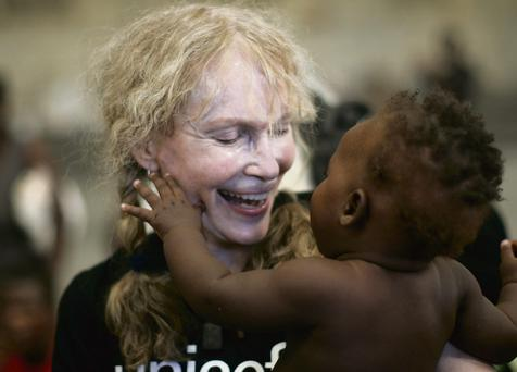 OH MIA, OH MY: Clockwise from above, Farrow with a Haitian child in her role as a Unicef ambassador;