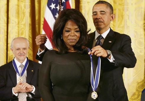 Mr Obama hands out the medals that were initiated by Mr Kennedy to Oprah Winfrey