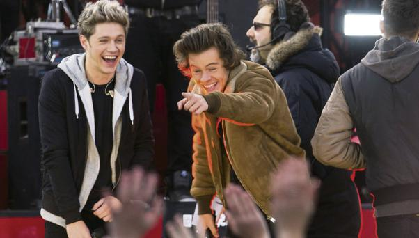 Singers Niall Horan and Harry Styles laugh as they perform on ABC's Good Morning America.