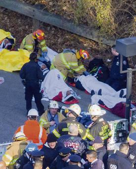 Rescue workers help the injured