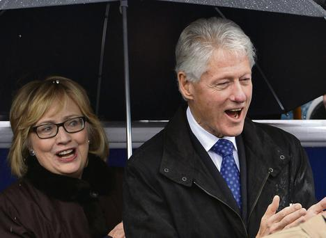 Former US President Bill Clinton and his wife Hillary. MIKE THEILER