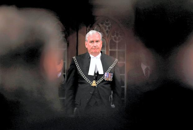 File photo: Canada's Sergeant-at-Arms Kevin Vickers is applauded in the House of Commons in Ottawa October 23, 2014.