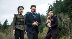 Diana Bang, as Sook, Seth Rogen, as Aaron, and James Franco, as Dave, in Columbia Pictures'