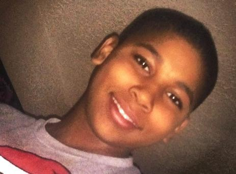Tamir E. Rice is pictured, as a shocking video in the US shows a police officer pushing a girl (14) to the ground after hand-cuffing her, soon after another officer fatally shot her younger brother within two seconds of the patrol car stopping near the boy