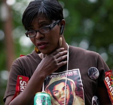 Denise Cromwell of the Black Lives Matter movement, looks over the memorial for Walter Scott after a vigil conducted by civil rights leader Rev. Al Sharpton at the site of Scott's death in North Charleston, South Carolina.