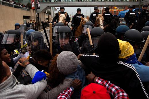 Protesters push against riot police during a rally in Baltimore, Maryland