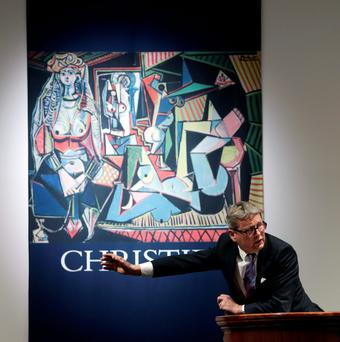Global President of Christie's Jussi Pylkkaenen auctions off the Pablo Picasso's painting 'Les femmes d'Alger