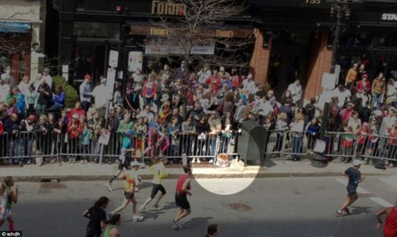 SCENE OF A MASSACRE: As weary runners reach the end of the gruelling charity run in Boston, the bomb explodes among the cheering families who had turned up to urge on their loved ones to reach the finish line