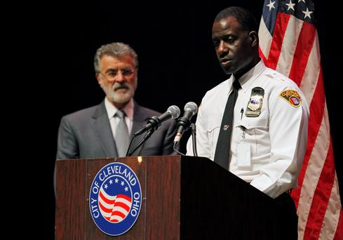 Cleveland Police Chief Calvin Williams speaks to the media as Cleveland Mayor Frank Jackson looks on at a news conference following the not guilty verdict for Cleveland police officer Michael Brelo on manslaughter charges in Cleveland, Ohio