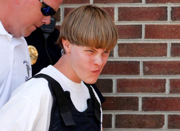 Police lead Dylann Roof (21) into the courthouse in Shelby, North Carolina