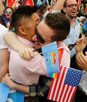 Gay rights supporters celebrate yesterday outside the Supreme Court building in Washington. Photo: Reuters / Jim Bourg