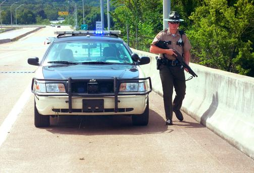 A Tennessee Highway Trooper patrols near the scene of the shooting near the Naval Reserve Center, in Chattanooga, Tennessee