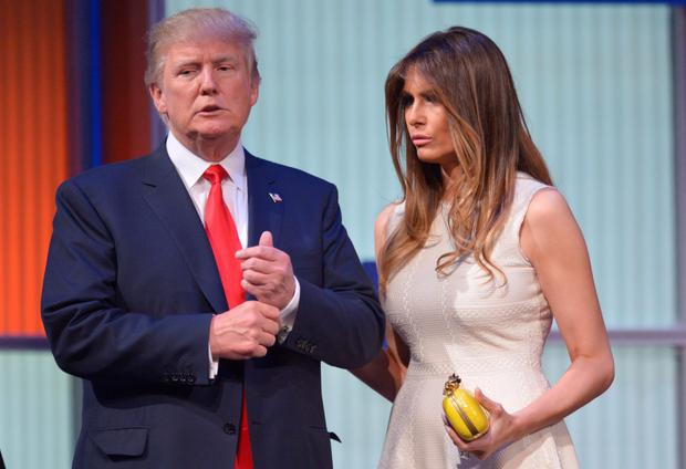 Donald Trump and his wife Melania Trump are seen on stage following the prime time Republican presidential debate.