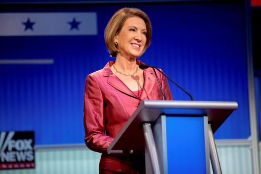 Carly Fiorina stands on stage for a pre-debate forum at the Quicken Loans Arena.