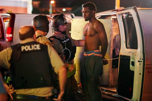 Police detain a man during a protest on West Florissant Avenue in Ferguson, Missouri. Photo: AFP/Getty Images.