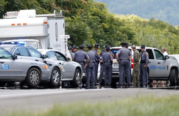 Virginia State Police vehicles line the edge of Highway I-66 in Fauquier County, Virginia, where shooting suspect 41-year-old Vester Flanagan shot and wounded himself