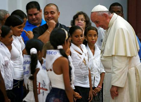 Pope Francis greets children at the basilica of Our Lady of Charity of El Cobre -Cuba's patron saint- in El Cobre, Santiago de Cuba.